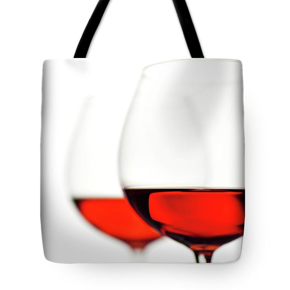 White Background Tote Bag featuring the photograph Glasses Of Wine by Ineskoleva