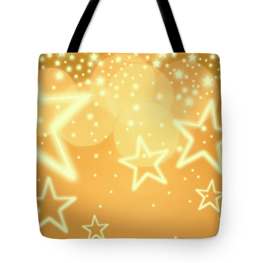 Christmas Lights Tote Bag featuring the photograph Glowing Background With Stars, Studio by Tetra Images