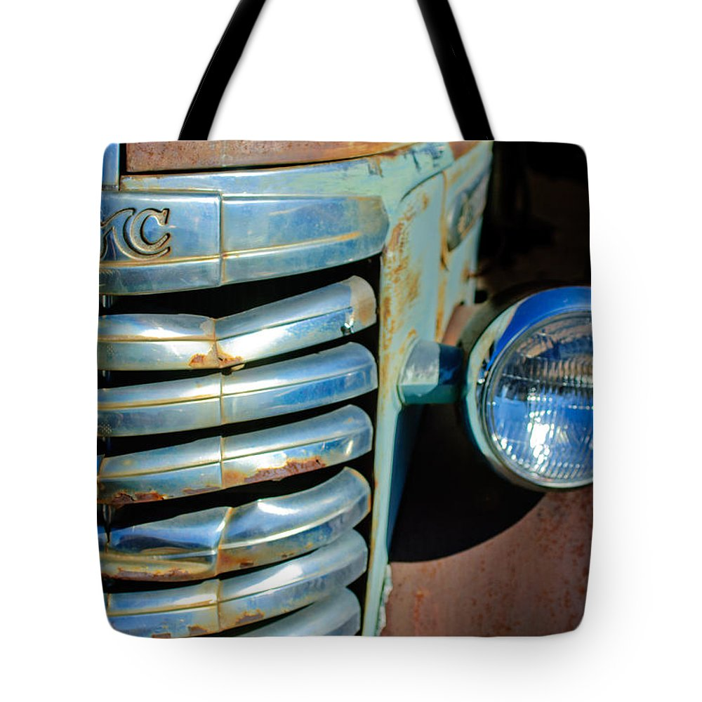 Gmc Truck Grille Emblem Tote Bag featuring the photograph Gmc Truck Grille Emblem by Jill Reger