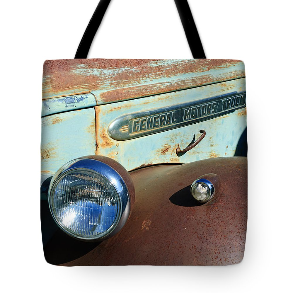 Gmc Truck Side Emblem Tote Bag featuring the photograph Gmc Truck Side Emblem by Jill Reger
