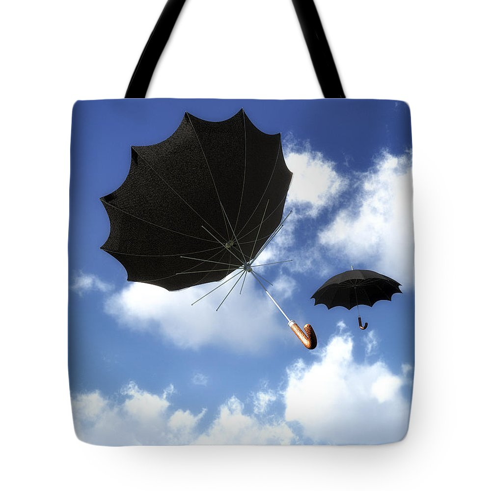 Umbrella Tote Bag featuring the photograph Going Down Fast And Slow by Bob Orsillo