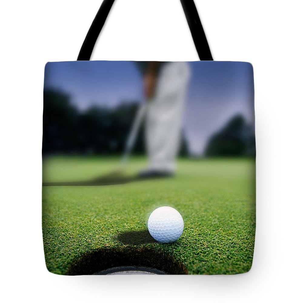 Day Tote Bag featuring the photograph Golf Ball Near Cup by Darren Greenwood