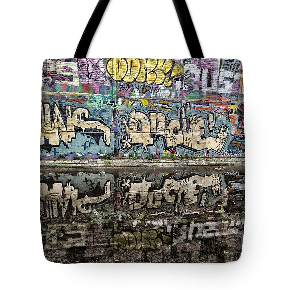 Graffity Wall Reflection Tote Bag featuring the photograph Graffity Reflection by Brothers Beerens