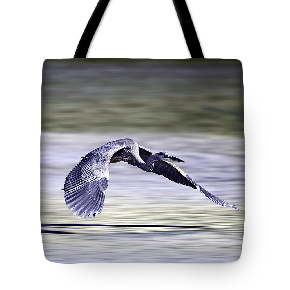Great Blue Heron Tote Bag featuring the photograph Great Blue Heron In Flight by John Haldane