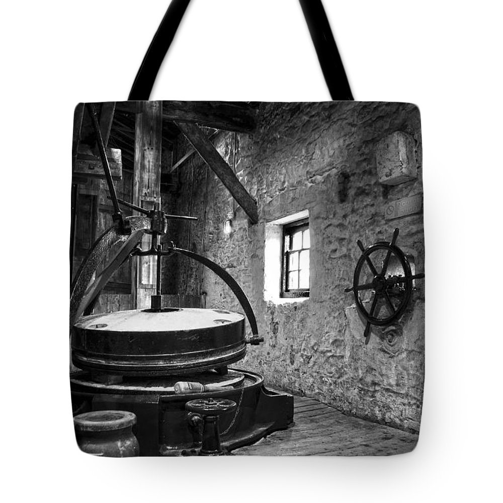 Grinder Tote Bag featuring the photograph Grinder For Unmalted Barley In An Old Distillery by RicardMN Photography