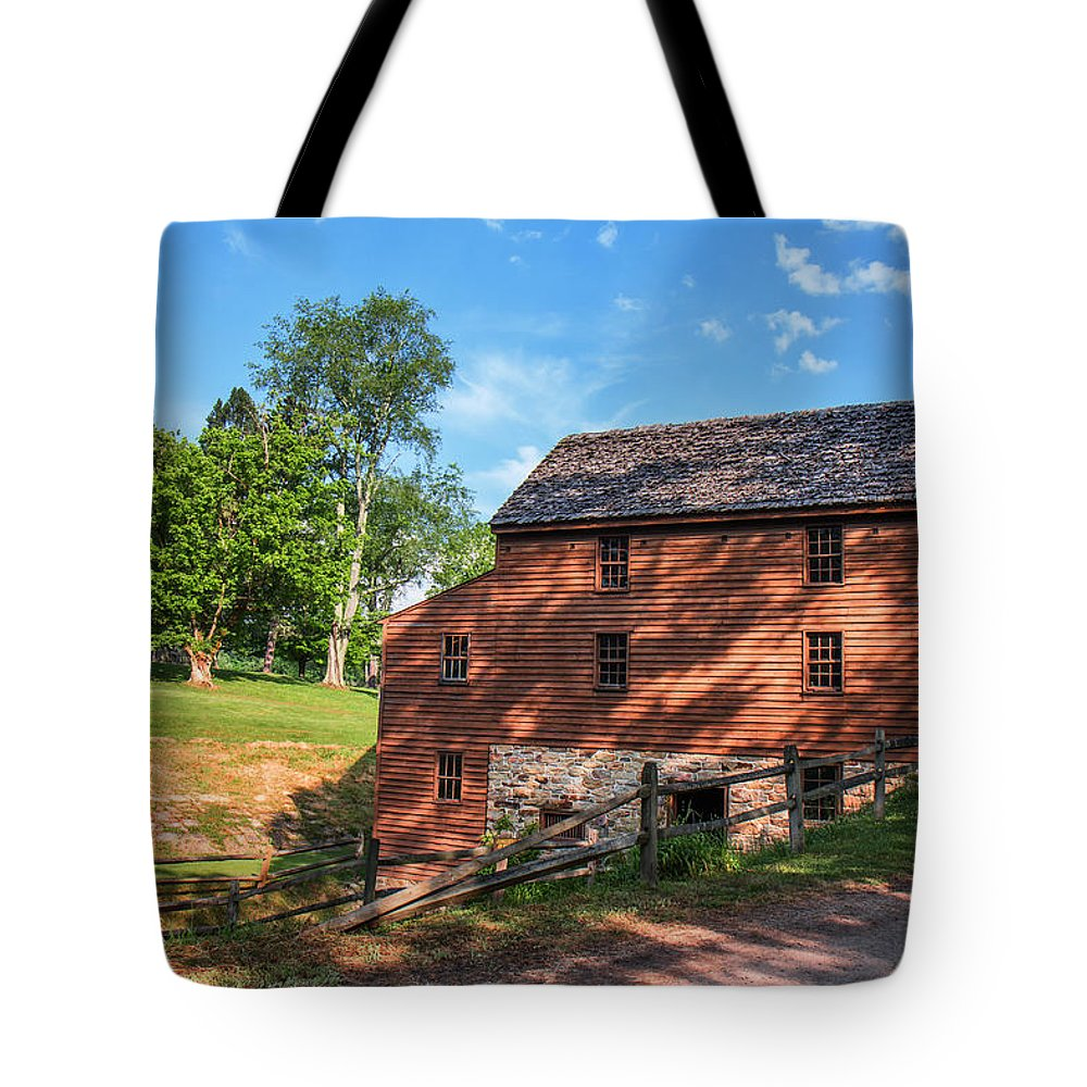 Jackson's Mill Tote Bag featuring the photograph Gristmill At The Farmstead by Mary Almond