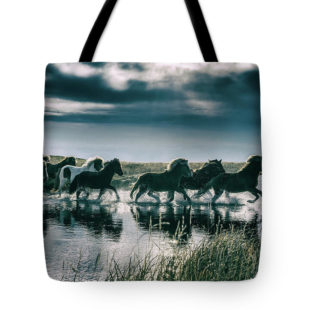 Horse Tote Bag featuring the photograph Group Of Horses Crossing A River by Arctic-images