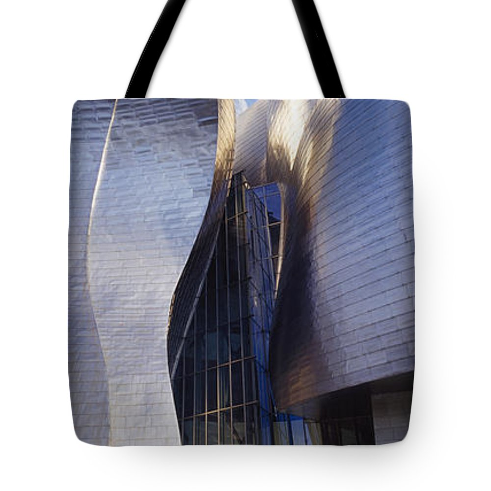 Panoramic Tote Bag featuring the photograph Guggenheim Museum Exterior by Toby Adamson