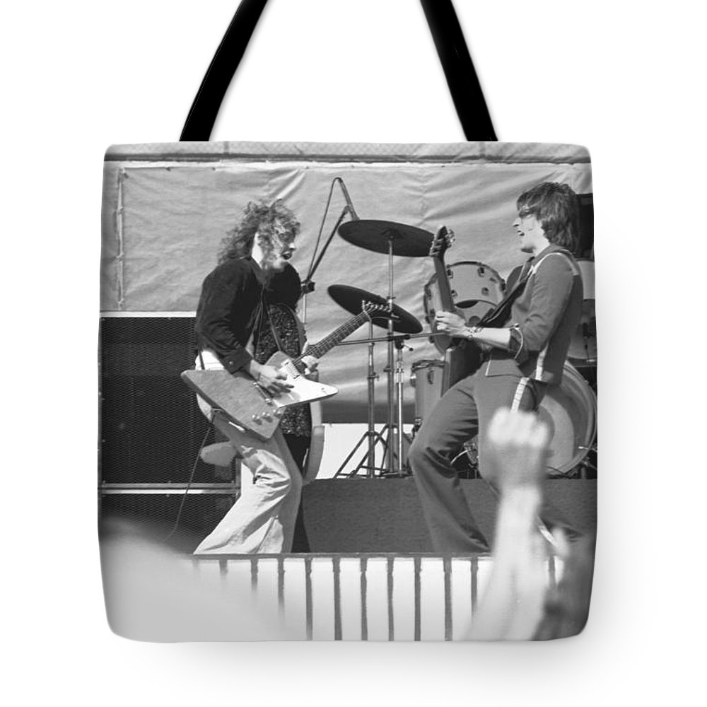 Peter Frampton Tote Bag featuring the photograph Guitar Jam At Day On The Green In Oakland 1976 by Ben Upham