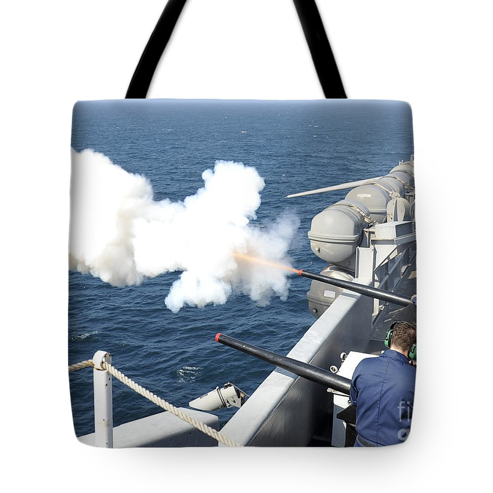 Uss Nimitz Tote Bag featuring the photograph Gunners Mates Test Fire The Ships by Stocktrek Images