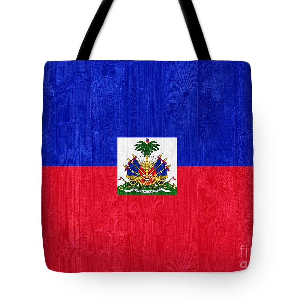 Haiti Tote Bag featuring the photograph Haiti Flag by Luis Alvarenga