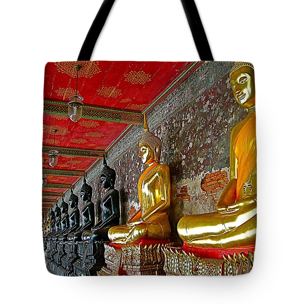Hall Of Buddhas In Wat Suthat In Bangkok Tote Bag featuring the photograph Hall Of Buddhas At Wat Suthat In Bangkok-thailand by Ruth Hager