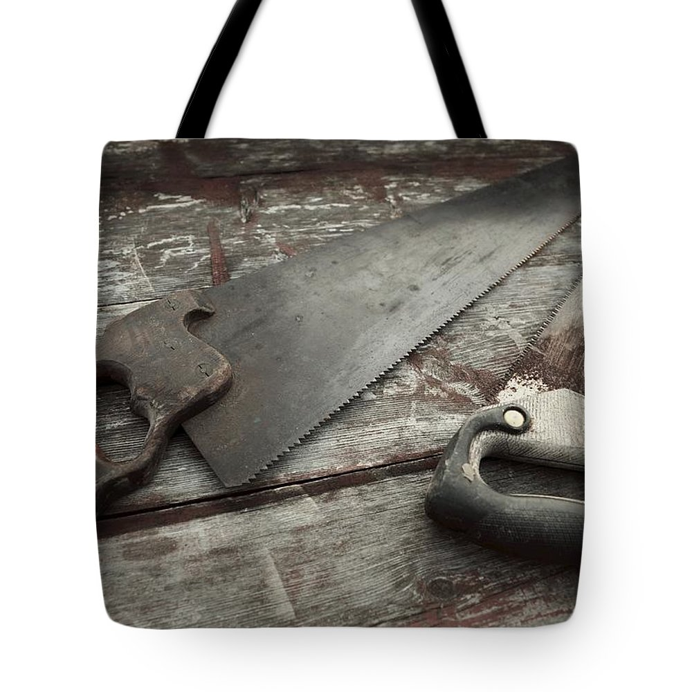 Hand Saw Tote Bag featuring the photograph Hand Made by Photographic Arts And Design Studio