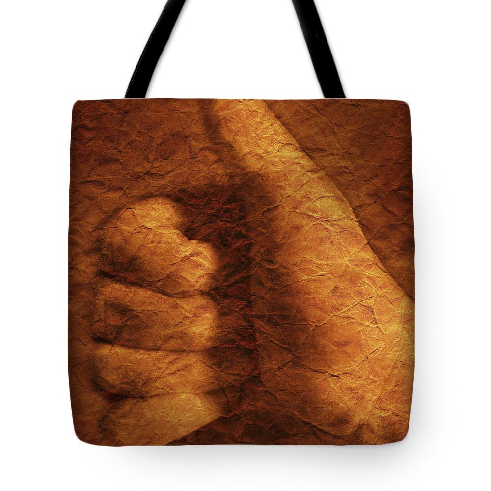 Achievement Tote Bag featuring the photograph Hand With Thumbs Up Sign by Don Hammond