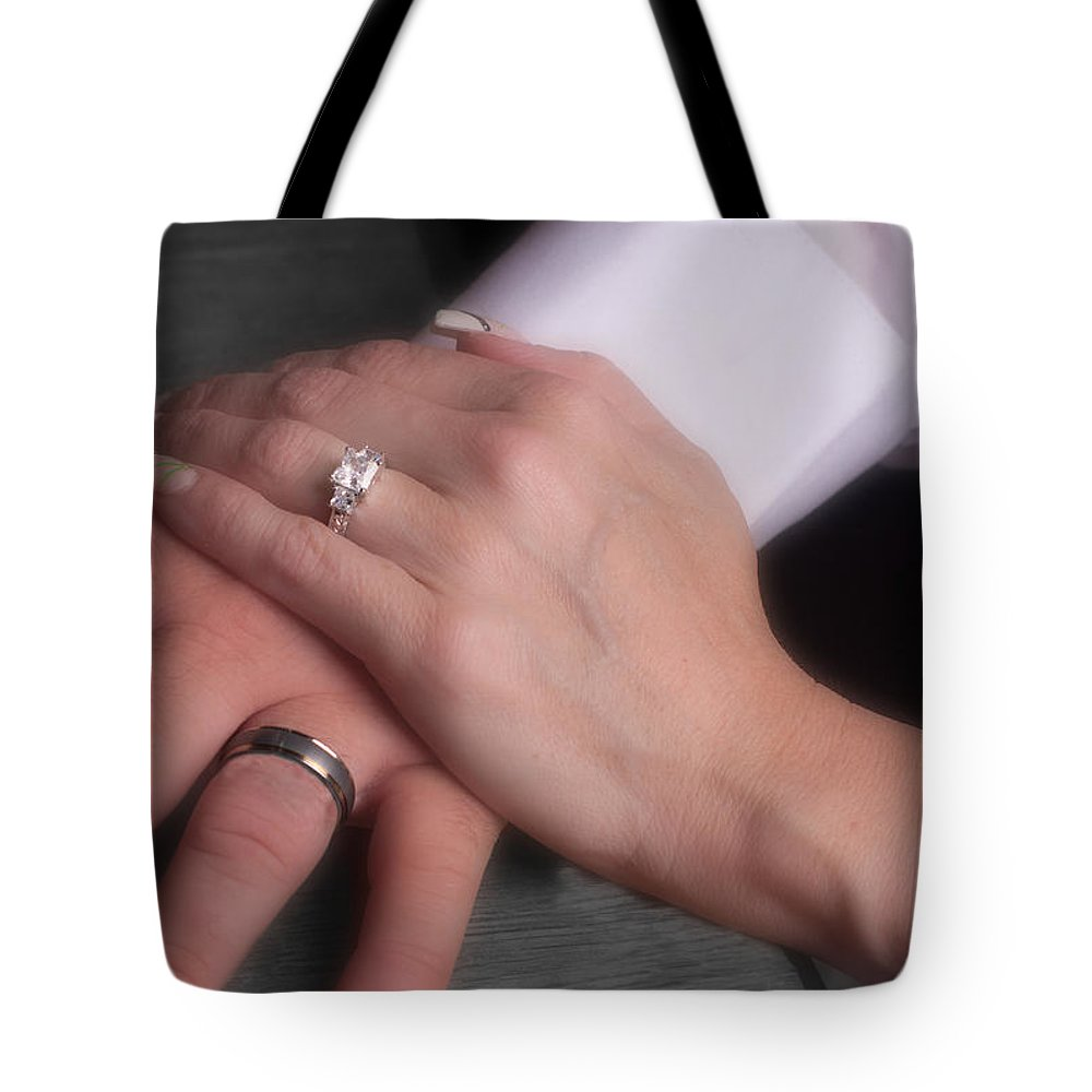 Band Tote Bag featuring the photograph Hands With Wedding Rings by Gunter Nezhoda