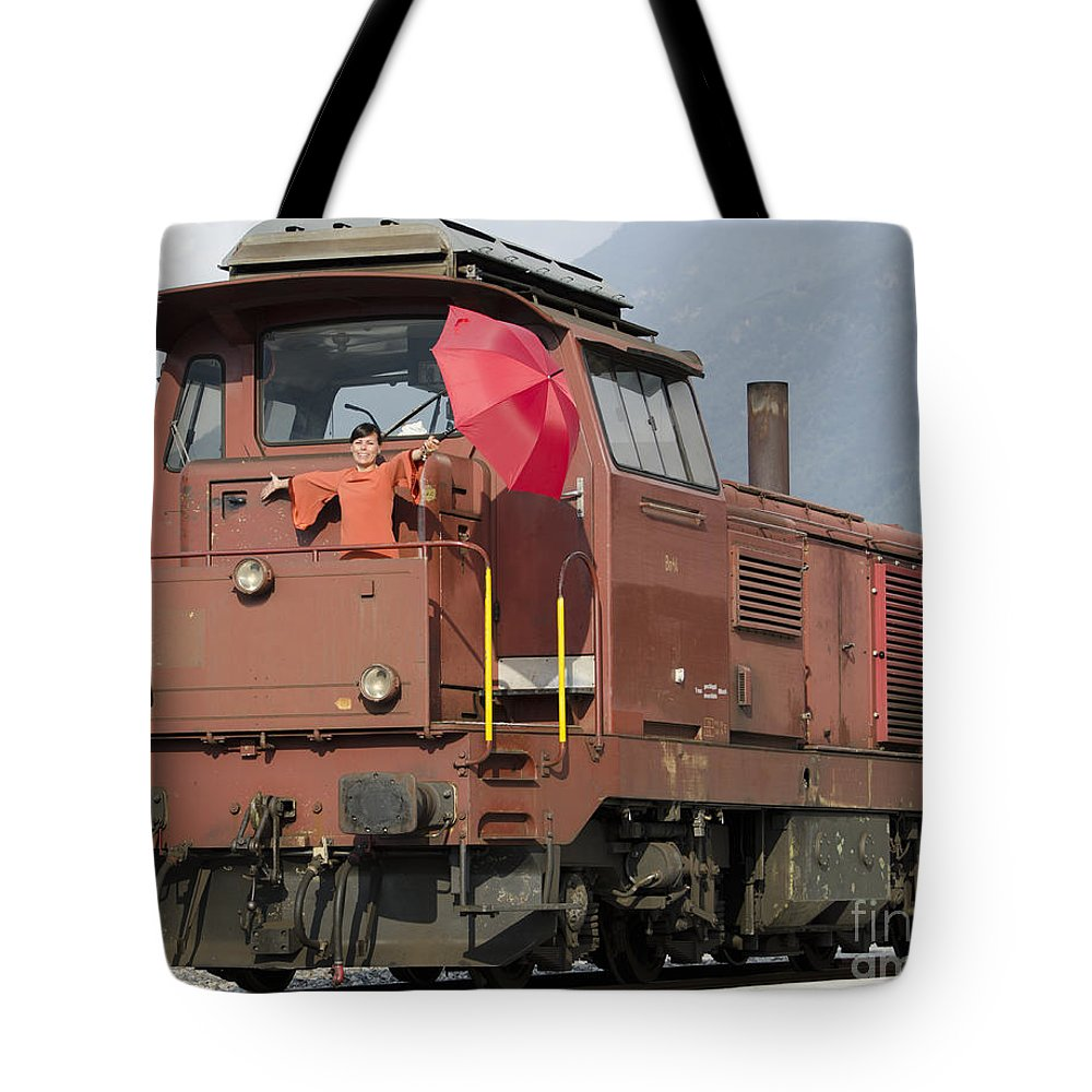 Woman Tote Bag featuring the photograph Happy Woman Standing On Train by Mats Silvan