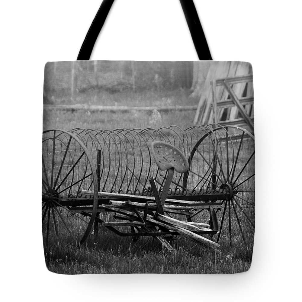 Black And White Tote Bag featuring the photograph Hay Rake by Eric Liller