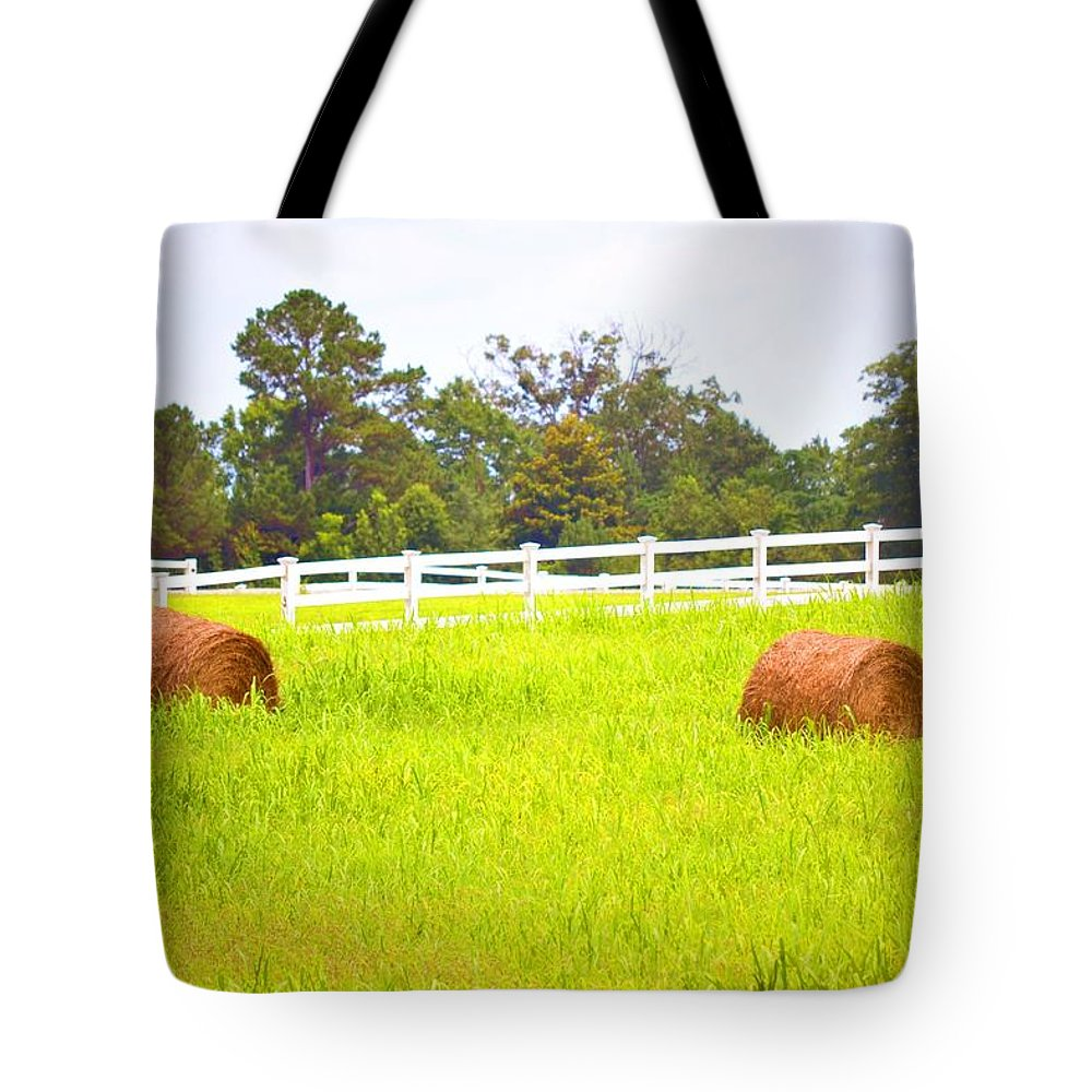 Hayrolls Tote Bag featuring the photograph Hayrolls And Fences by Tara Potts