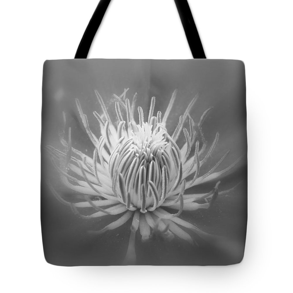 Clematic Tote Bag featuring the photograph Heart Of A Red Clematis In Black And White by Mother Nature