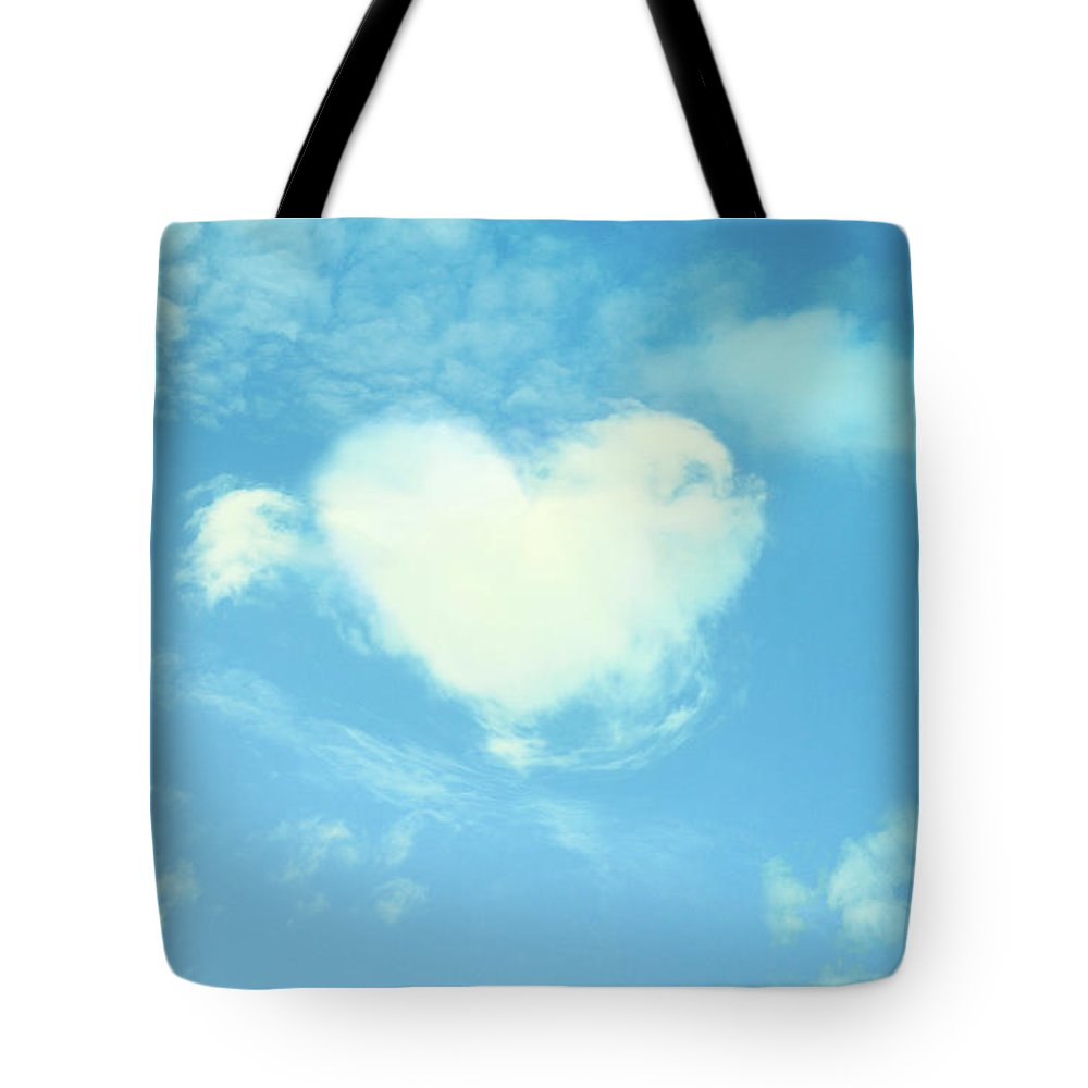 Outdoors Tote Bag featuring the photograph Heart-shaped Cloud by Yurif