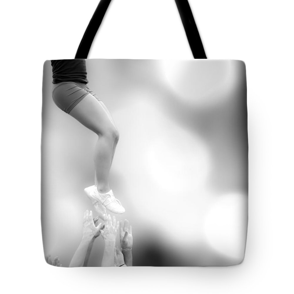 Gymnastics Tote Bag featuring the photograph Helping Hands by Bob Orsillo