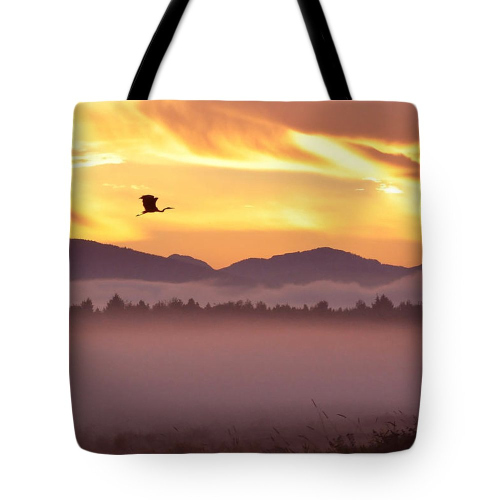 Sunrise Tote Bag featuring the photograph Heron's Sunrise by Michele Broadfoot