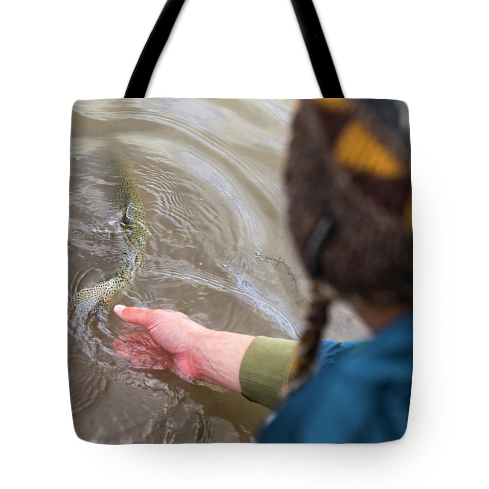 Caucasian Ethnicity Tote Bag featuring the photograph High Angle View Of A Person Releasing by Wray Sinclair