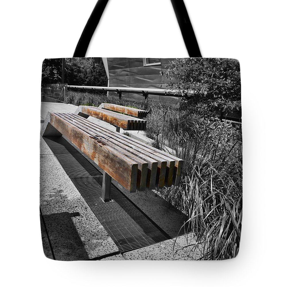 Evie Tote Bag featuring the photograph High Line Benches Black And White by Evie Carrier