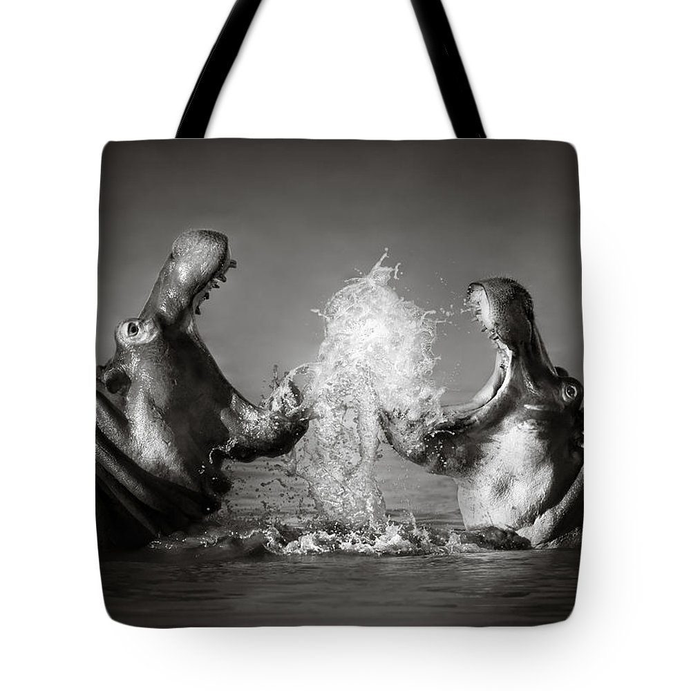 Hippo Tote Bag featuring the photograph Hippo's fighting by Johan Swanepoel