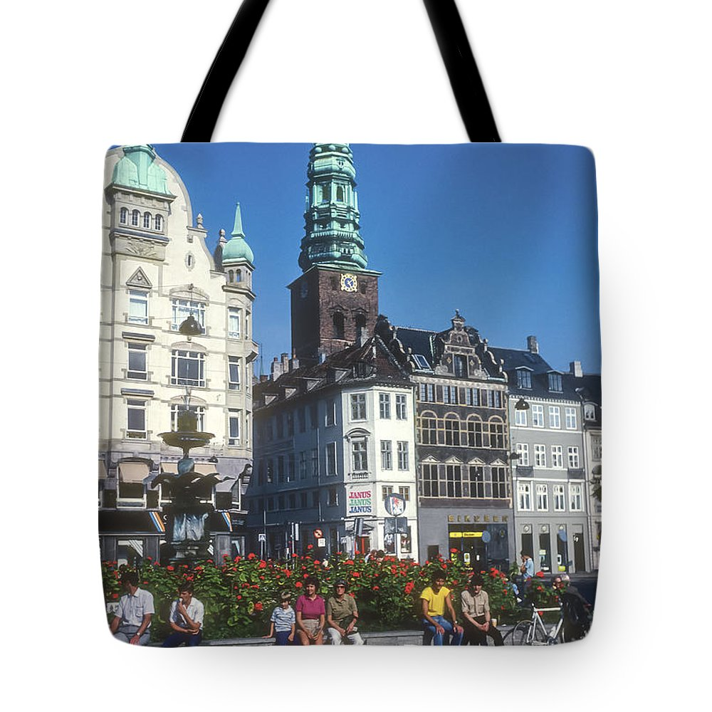 Højbro Hojbro Square Copenhagen Denmark City Squares Cities Cityscape Cityscapes St. Nicholas Church Tower Clock Towers Building Buildings Structures Stork Fountain Fountains People Person Persons Men Man Boy Boys Flower Flowers Creatures Tote Bag featuring the photograph Hojbro Square by Bob Phillips