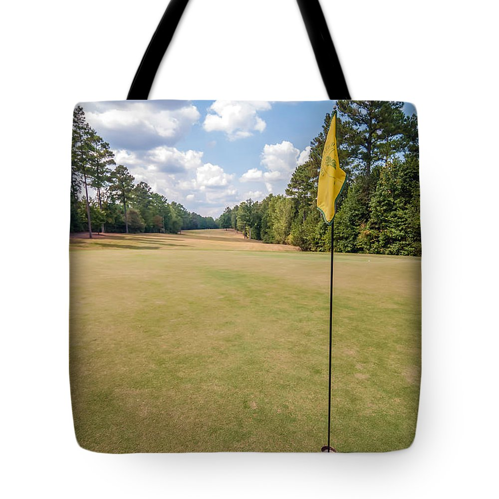 Beauty Tote Bag featuring the photograph Hole Flag At A Golf Course by Alex Grichenko