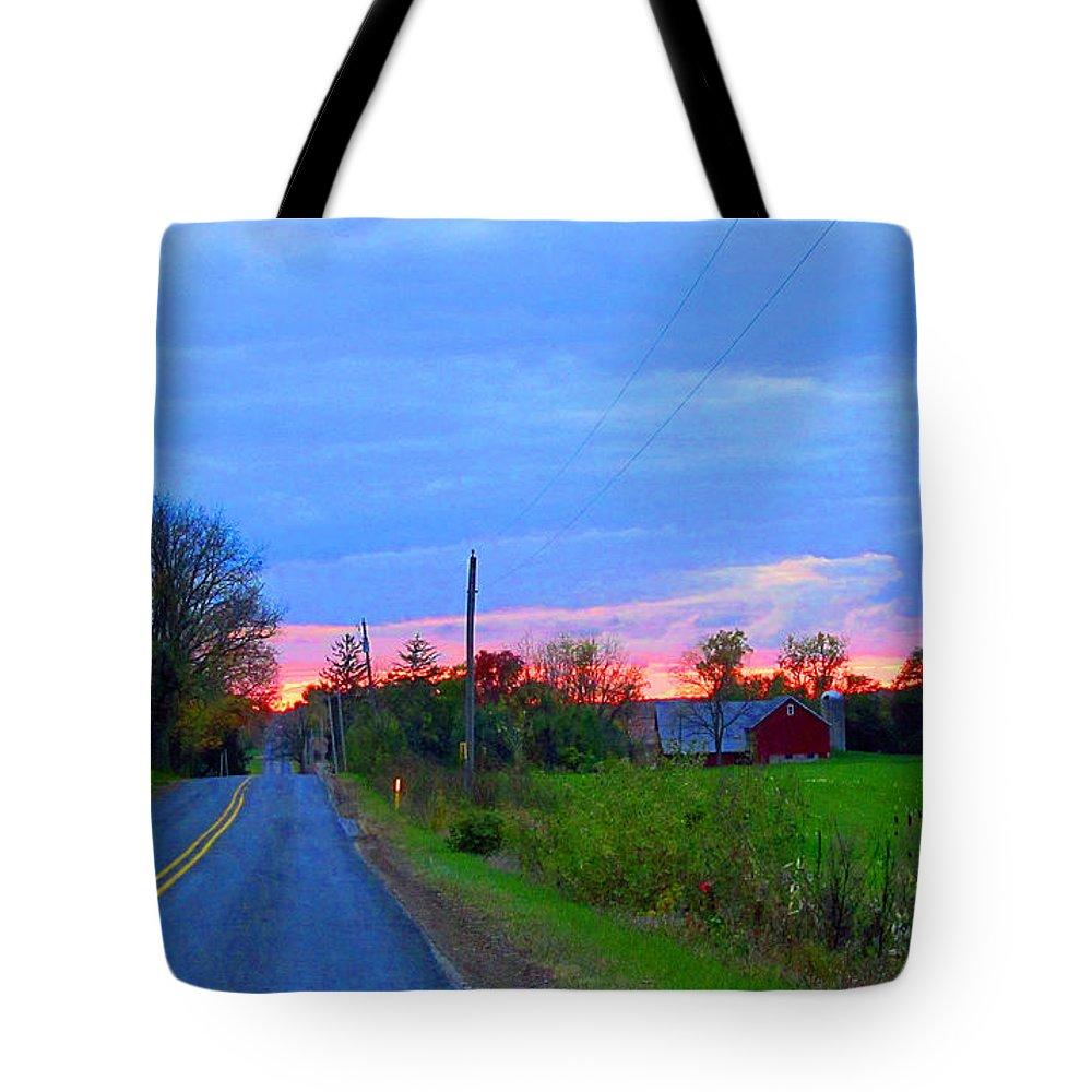 Sun Tote Bag featuring the photograph Horizon Sunset by Tina M Wenger