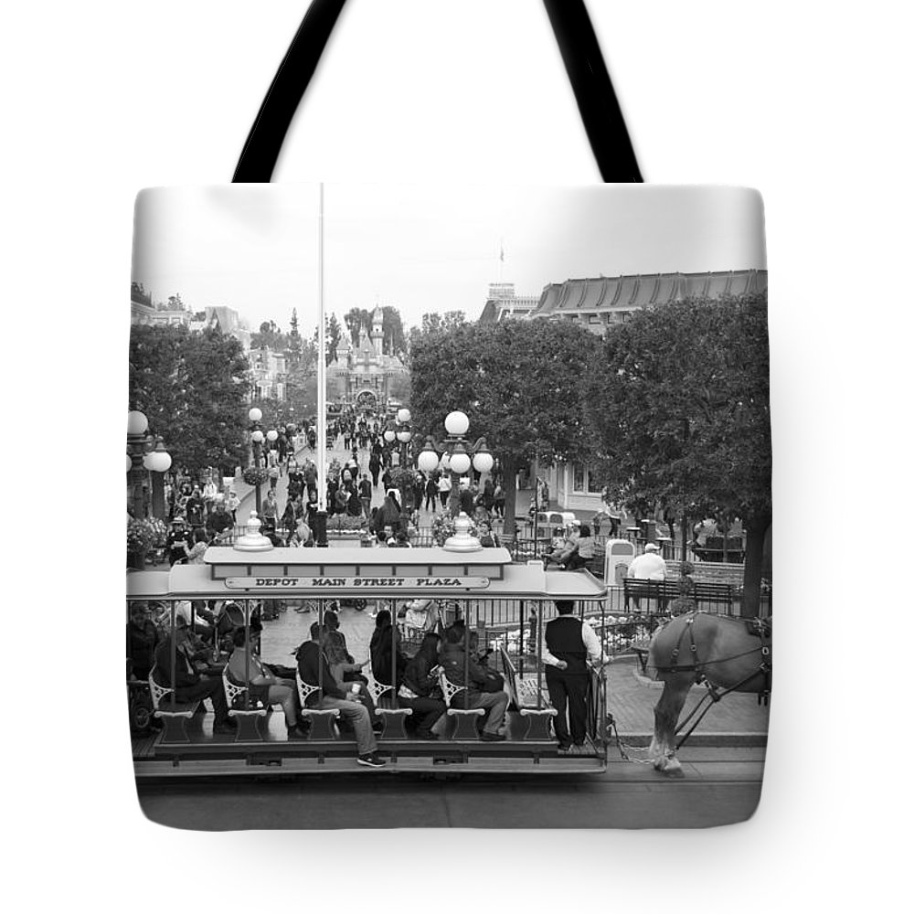 Disney Tote Bag featuring the photograph Horse And Trolley Main Street Disneyland Bw by Thomas Woolworth