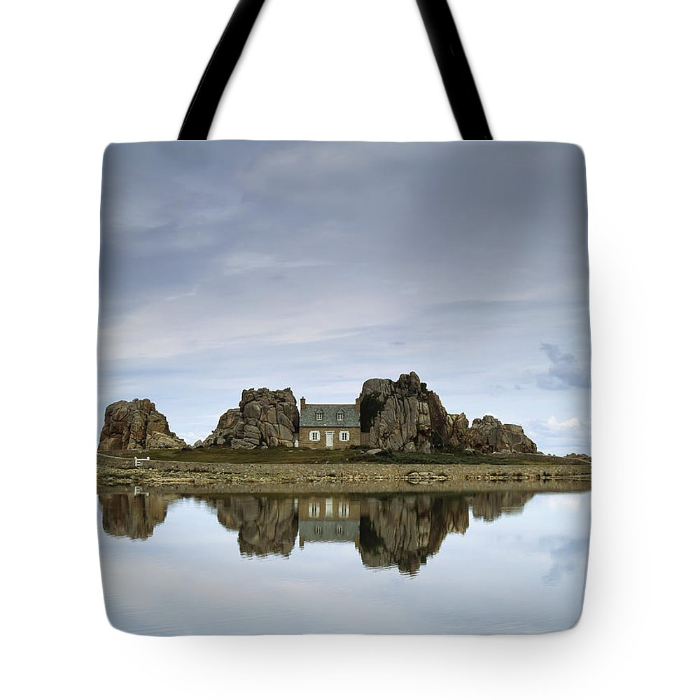 Sea Shore Tote Bag featuring the photograph House In Between Rocks Reflected by Ellen Rooney