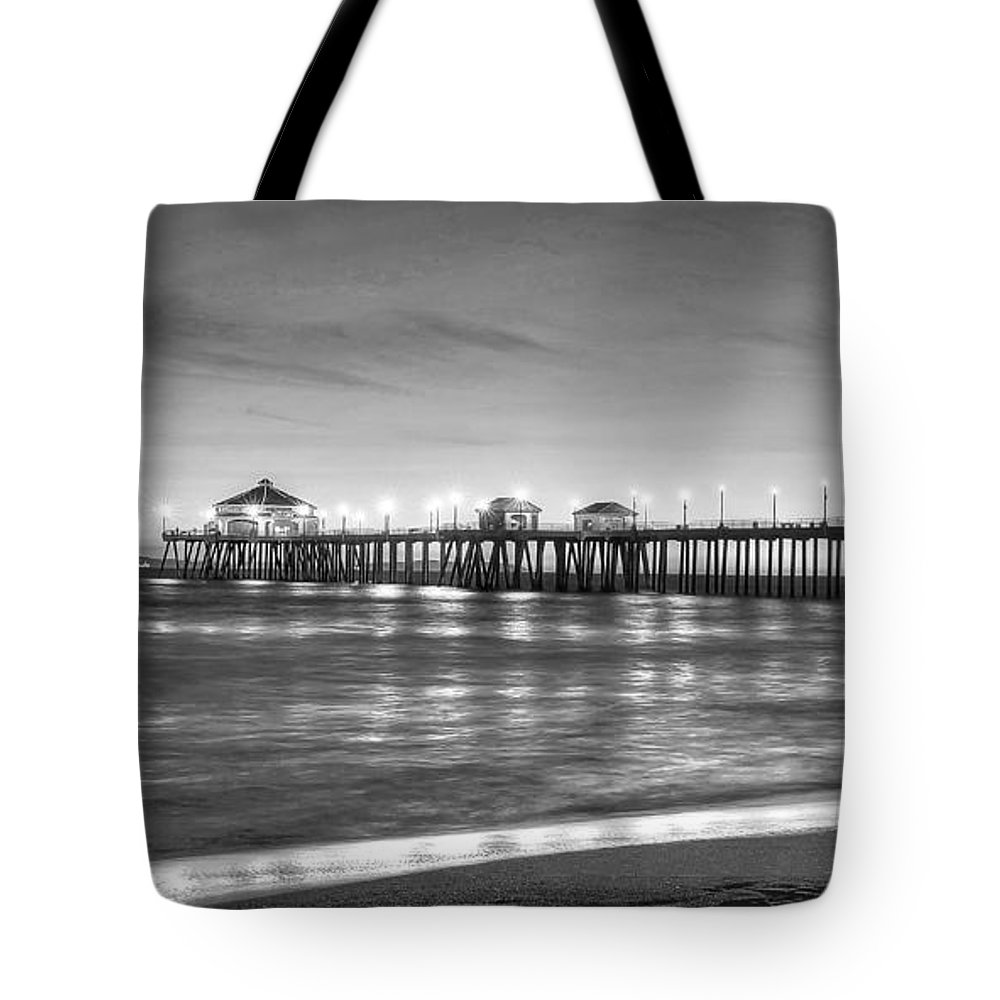Huntington Beach Tote Bag featuring the photograph Huntington Beach Pier Twilight - Black And White by Jim Carrell