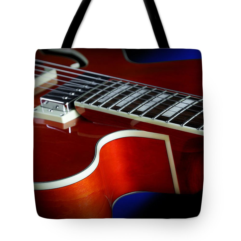 Guitar Tote Bag featuring the photograph Ibanez Af75 Hollowbody Electric Guitar Cutaway Detail by John Cardamone