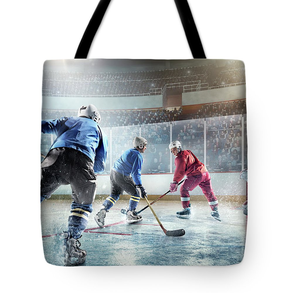 Sports Helmet Tote Bag featuring the photograph Ice Hockey Players In Action by Dmytro Aksonov