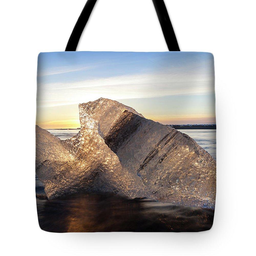 Scenics Tote Bag featuring the photograph Iceberg In Sea By Jokulsarlon Glacier by Peter Adams