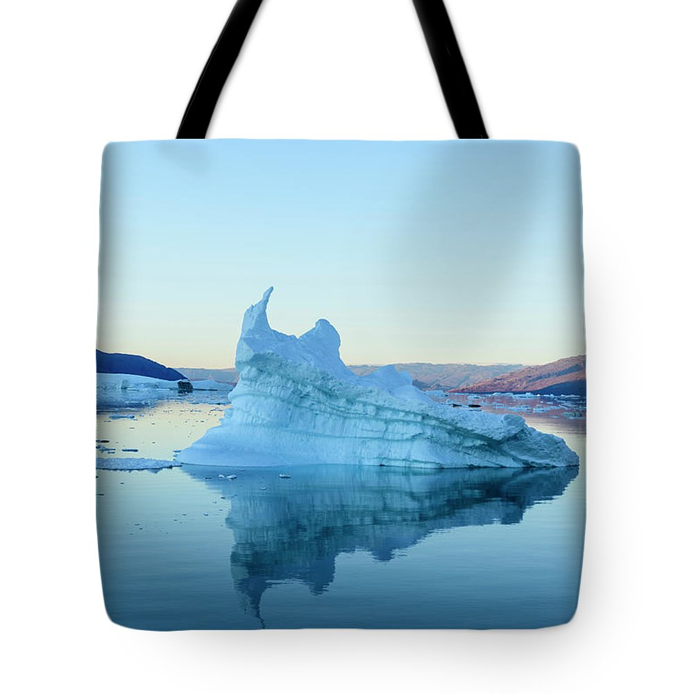 Scenics Tote Bag featuring the photograph Iceberg In The Scoresby Sund by Berthold Trenkel
