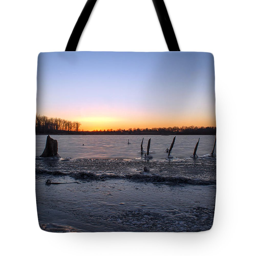 Ice Tote Bag featuring the photograph Icy Lake Sunset by Thomas Sellberg