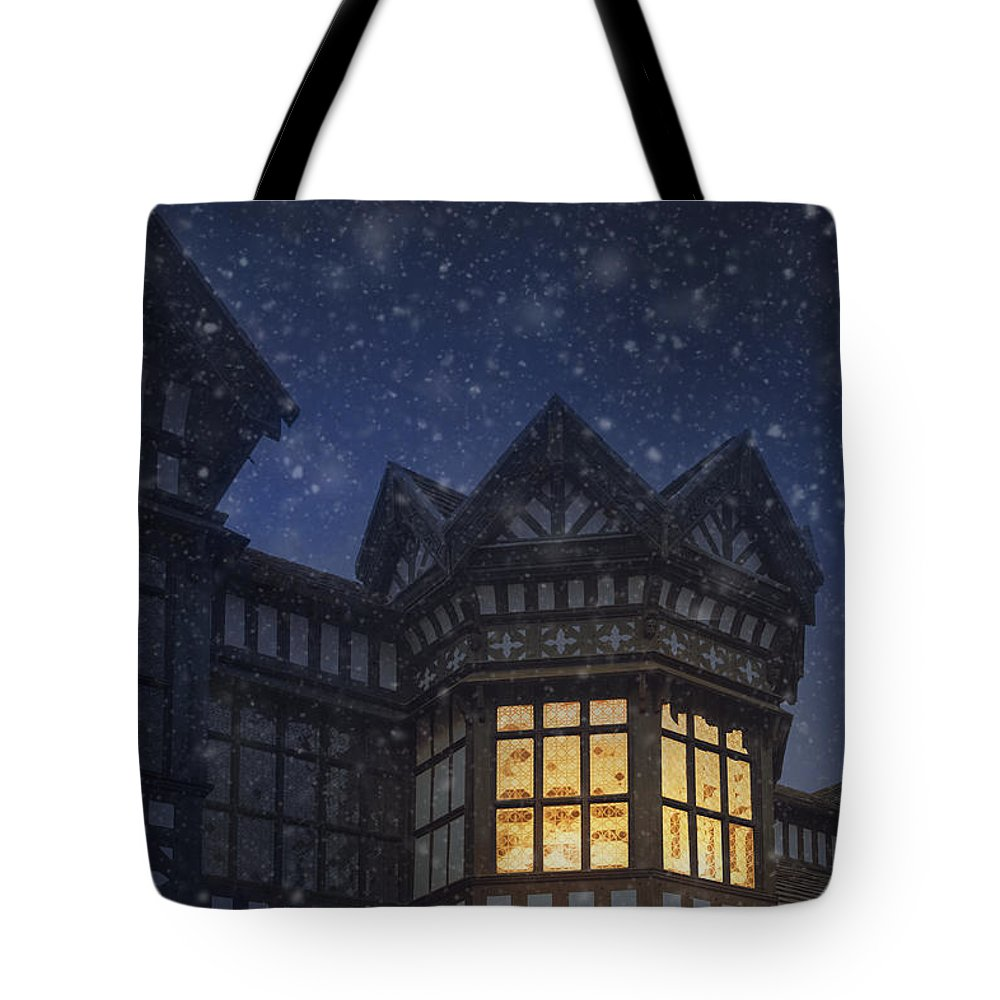 Tudor Tote Bag featuring the photograph Illuminated Windows Of A Turret In A Timber Framed Tudor House by Lee Avison