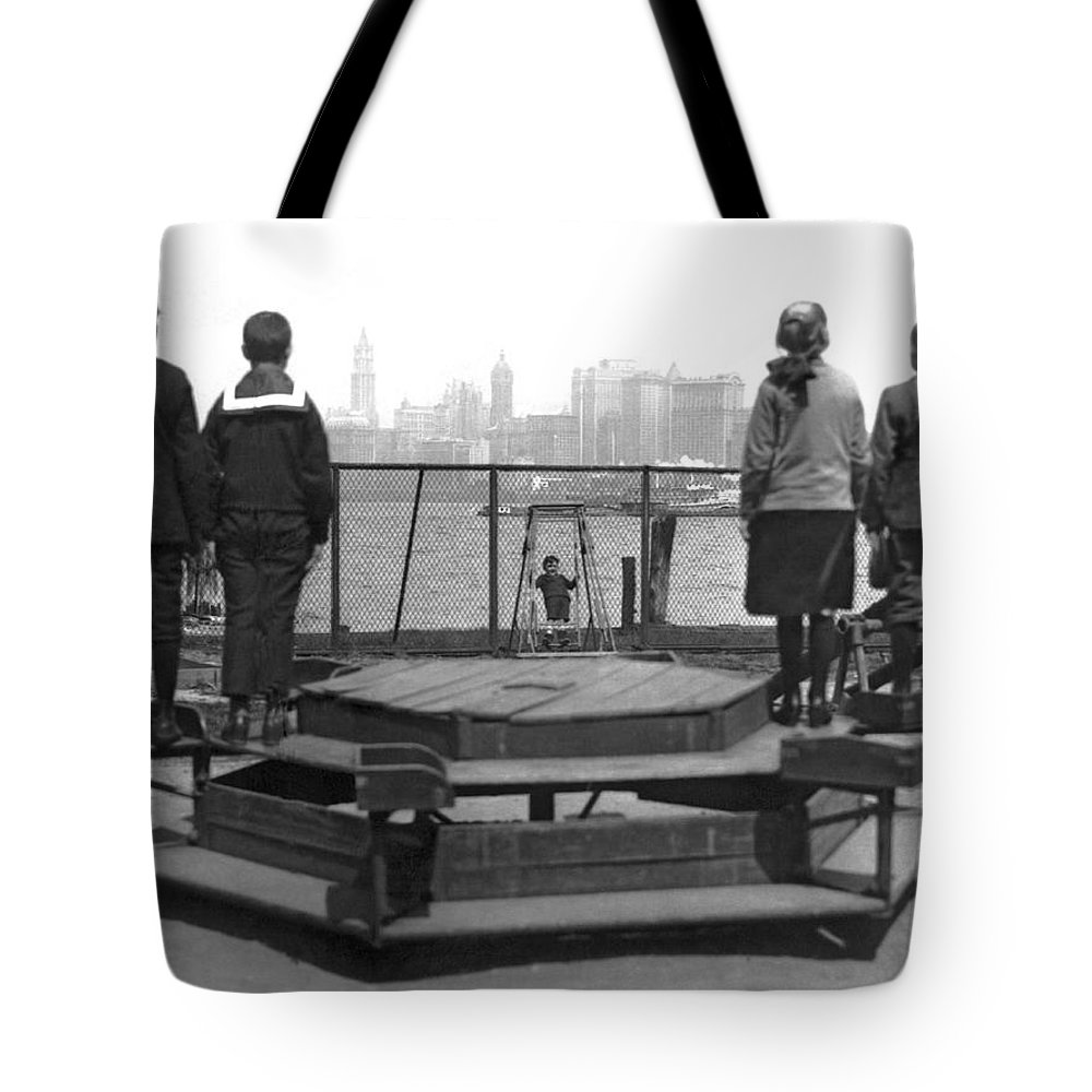 1913 Tote Bag featuring the photograph Immigrants At Ellis Island by Underwood Archives