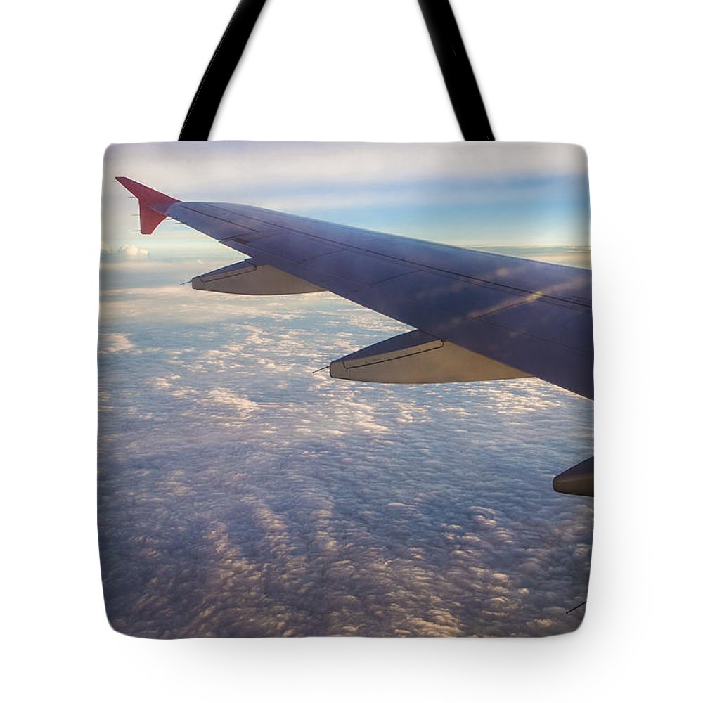 Airplane Tote Bag featuring the photograph In Flight by John McGraw