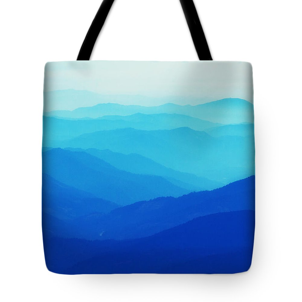 Mountains Tote Bag featuring the photograph In The Blue by Lisa Chorny