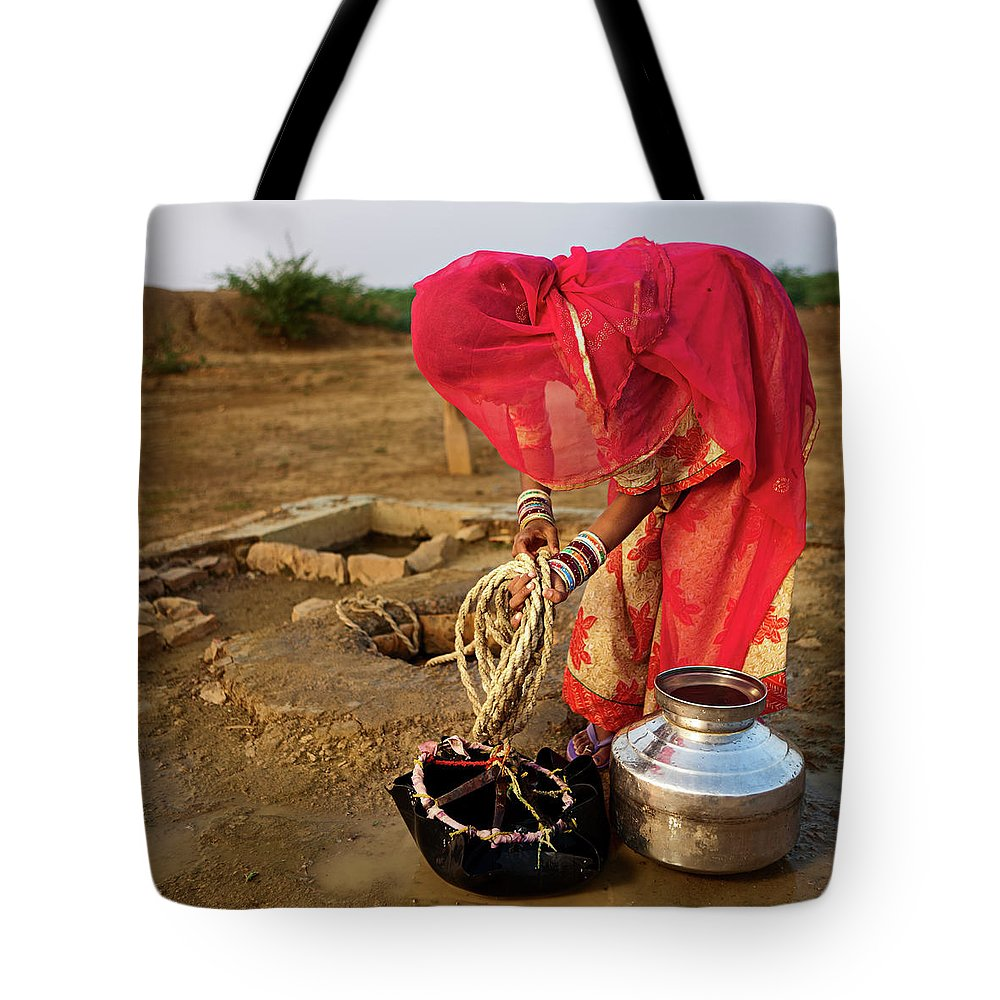 Working Tote Bag featuring the photograph Indian Woman Getting Water From The by Hadynyah