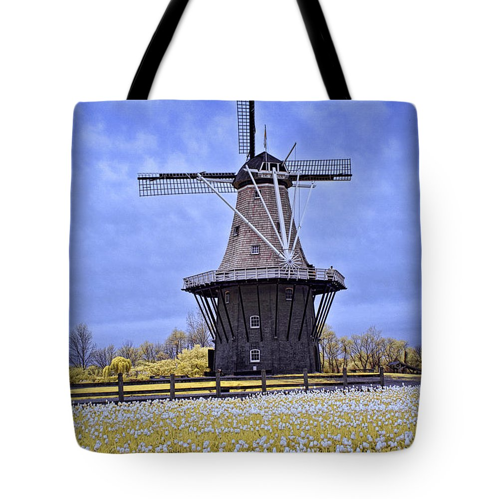 Art Tote Bag featuring the photograph Infrared Photo Of The Dezwaan Dutch Windmill On Windmill Island In Holland Michigan by Randall Nyhof