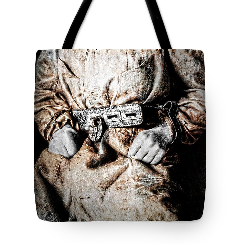 Insane Tote Bag featuring the photograph Insane Person In Restraints by Daniel Hagerman