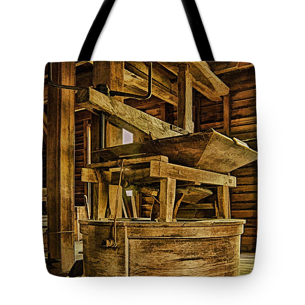 Mingus Mill Tote Bag featuring the photograph Inside Mingus Grist Mill by Priscilla Burgers