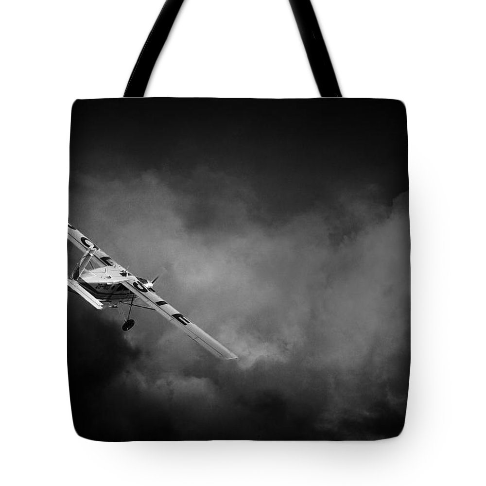 Pilatus Pc6 Porter Tote Bag featuring the photograph Into The Storm by Paul Job