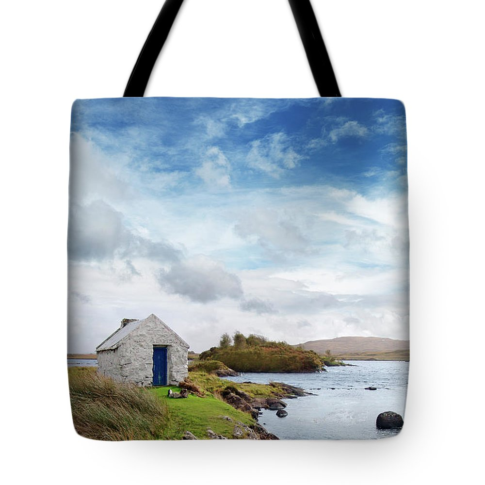 Water's Edge Tote Bag featuring the photograph Irish Landscape In Connemara by Narvikk
